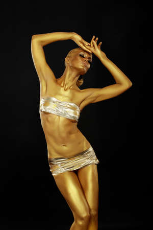 reverie: Body Art  Coloring  Graceful Woman with Shiny Gold Makeup in Reverie  Golden Statue Stock Photo