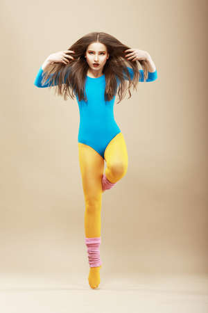 tiptoe: Aerobics  Gymnastics  Shapely Woman in Sportswear and Woolen Gaiters  Vitality