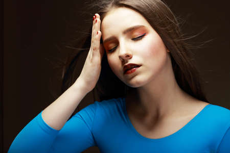 scourge: Distress  Woe  Upset Tired Woman Touching her Forehead  Difficulties Stock Photo