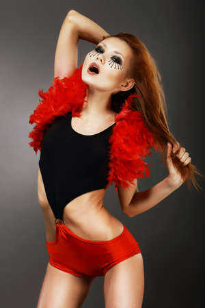 Showgirl  Amazing Red Hair Asian Woman with Fantastic Makeup in Clubwear Stock Photo - 19386482