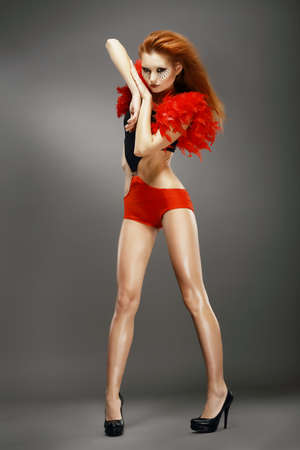 Entertainment. Shapely Redhead Asian Showgirl in Night Disco Club. Dance Stock Photo - 19432814