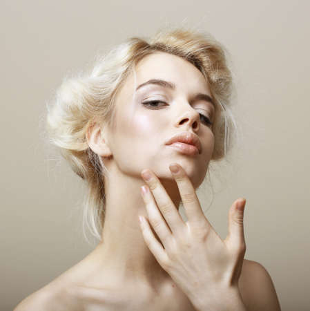 upsweep: Sentimentality. Natural Blonde Woman touching her Clean Face. Pampering