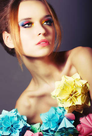 Portrait of Young Beauty with Colorful Origami Flowers. Bright Eye Make-Up Stock Photo - 19428715