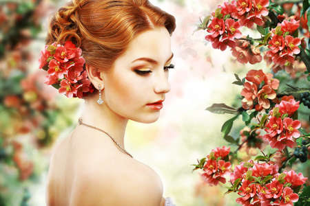 Profile of Red Hair Beauty over Natural Floral Background photo