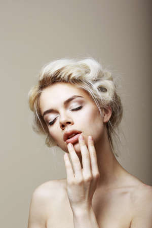 Purity. Sensual Romantic Blond Female with Closed Eyes touching her Face. Muse Stock Photo - 19455532