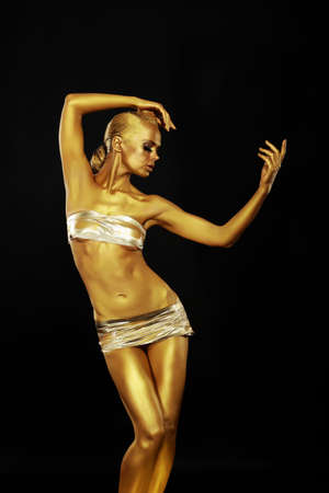 gilding: Radiance. Golden Statue. Gilded Womans Body. Gold Bodyart