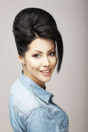 charisma: Happiness. Charisma. Sexy Brunette in Blue Jeans Jacket. Refinement Stock Photo