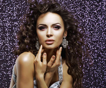 Jewelry. Aristocratic Gorgeous Woman with Shining Earrings. Holiday Makeup photo