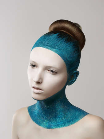 glitter makeup:  Expression. Fantasy. Eccentric Woman with Blue Painted Skin and Hair. Coloring