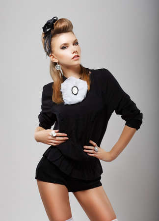 Individuality. Stylish Woman in Black Costume - Shorts and Blouse. Fashion Style photo