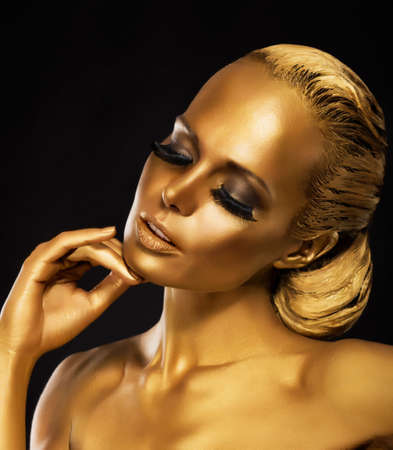 skin color: Stage  Theater  Luxurious Woman in her Dreams  Golden Color  Jewelry Stock Photo