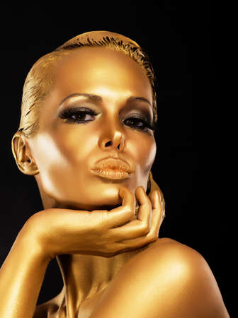 Fantasy  Face of Styled Enigmatic Woman with Gold Make-up  Luxury Stock Photo