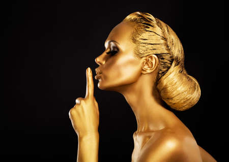 Secrecy  Bodyart  Golden Woman showing Silence Sign  Hush