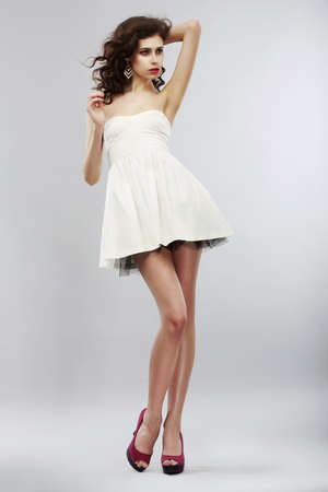 Minimalism  Fashion Style  Stylish Woman in Light White Dress  Summer Collection photo