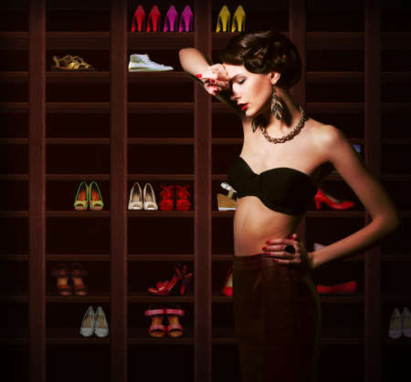 Confusion  Upset Woman Choosing what to Wear  Wardrobe with Footwear Stock Photo - 19725743