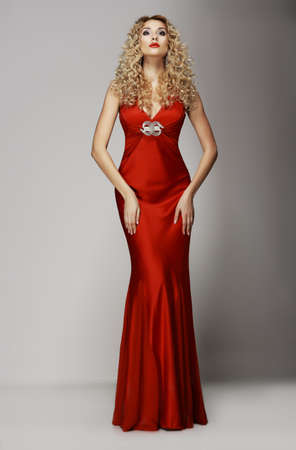 attractiveness: Sophistication  Seductive Woman in Red Fashion Dress  Charisma