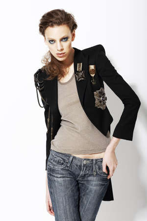 nifty: Individuality  Beautiful Eccentric Fashion Model in Jeans and Bijou on Jacket Stock Photo