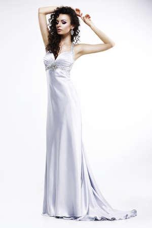 Gorgeous Lady in Light Silk Sleeveless Dress with Platinum Jewelry Stock Photo - 19875682