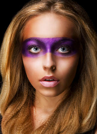 painted face mask: Portrait of Style woman with Vivid Violet Make-up