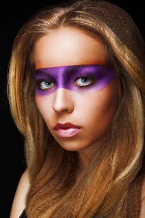 Trendy Woman with Shiny Colorful Makeup photo