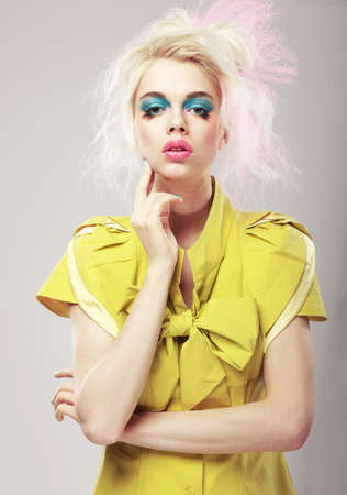 Vivid Blond Hair Woman with Conspicuous Makeup photo