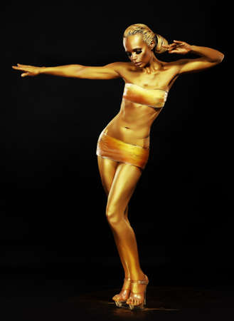 Radiance. Fantasy. Golden Woman Performing in Night Club. Lights photo
