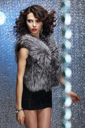 Glamour. Shapely Good Looking Woman in Gray Fur Waistcoat photo
