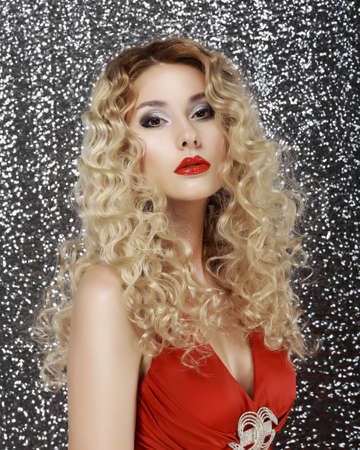 christmas tide: Glamor. Portrait of Luxurious Classy Blond with Sexy Red Lips Stock Photo
