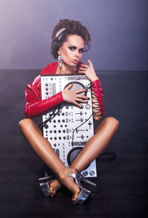 Entertainment. Woman sitting with DJ Mixer photo