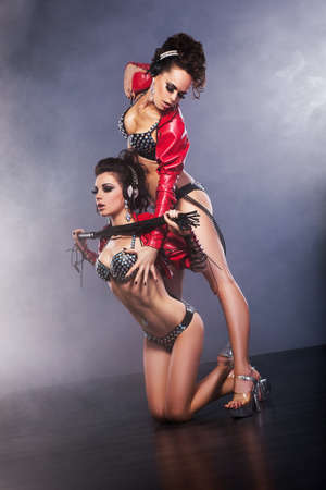 latex: Performance  Nightlife  Sexy half-dressed Flirtatious Women in Latex with Lash