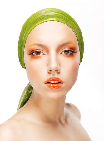 Art  Glamorous Woman in Green Headwear and Trendy Professional Make-up