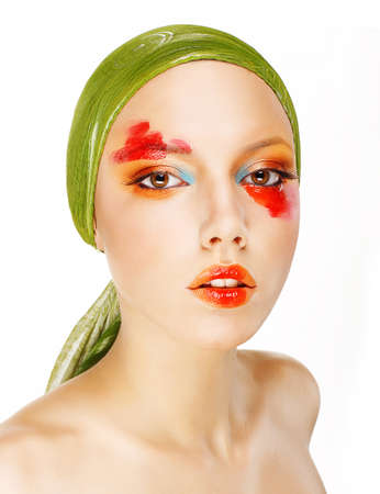 Fantasy  Glamor  Fashion Model in Green Shawl and Colorful Makeup photo