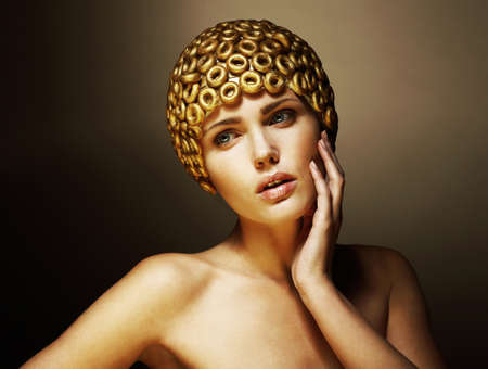 bonnet up: Creativity  Surreal Portrait of Stylized Woman with Golden Headwear as a Helmet
