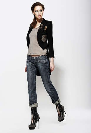 Fashionable Glamorous Woman in Jeans and High Boots  Vogue Style photo