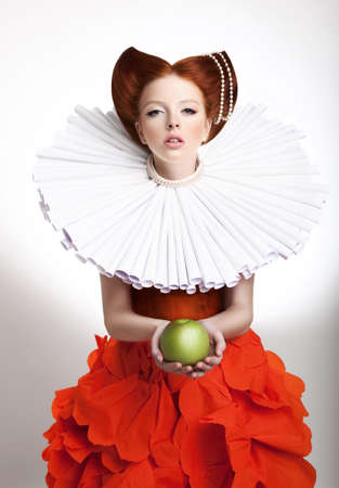 a frill: Retro Style. Portrait of Styled Redhead Woman Duchess in Vintage Frill
