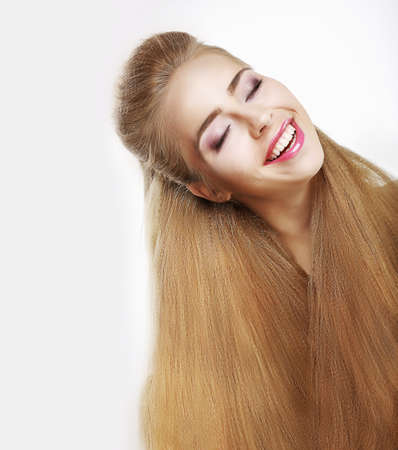 sincere: Sincere Smile. Jubilant Young Woman with Flowing Healthy Hairs. Pleasure Stock Photo