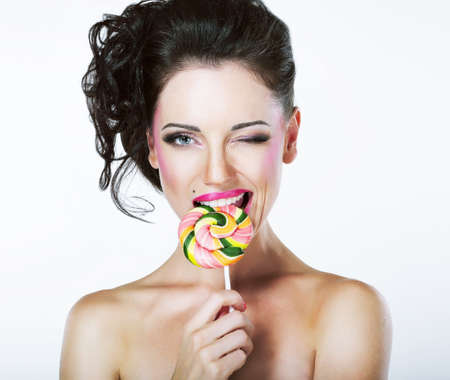 jester: Coquette  Funny Quaint Brunette with Colorful Lollipop Stock Photo
