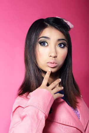 attractiveness: Attractiveness  Portrait of Asian Brunette with Big Surprised Eyes Stock Photo