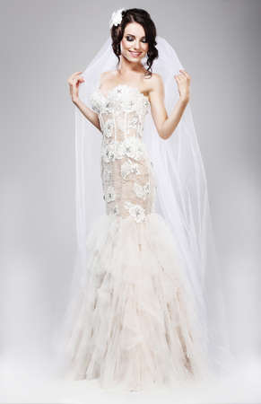 sophistication: Expectation  Beautiful Jubilant Bride in White Wedding Dress Stock Photo