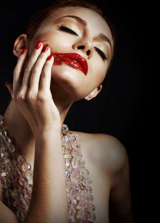smeary: Woman with Smeared Red Lipstick over Black Background Stock Photo