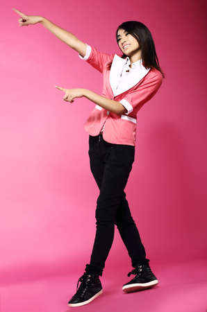 gaiety: Adolescence. Young Funny Asian Woman Gesturing with her Hands Stock Photo