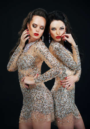 Luxury. Two Sexy Glamorous Women in Shiny Dresses photo