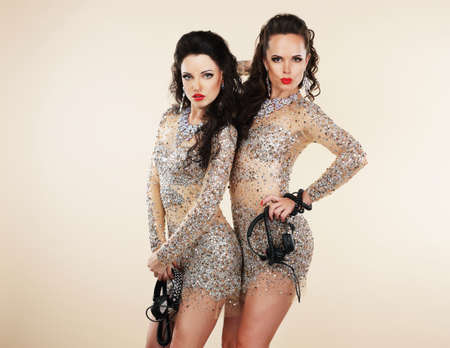 glitter makeup: Amusement  Two Showgirls with Headphones - Nightlife
