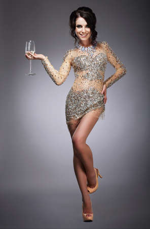 merriment: Happy Gorgeous Woman Holding Wineglass of Champagne