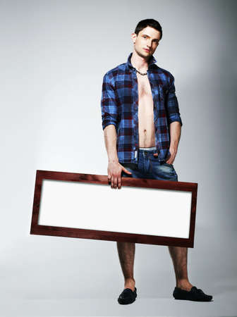 unbuttoned: Young Man Showing Placard with White Blank Space
