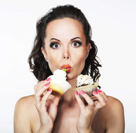 Gluttony  Hungry Funny Young Woman Greedily Eats  Cakes with Cream Stock Photo