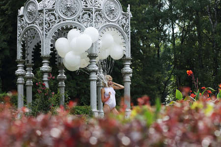 Lovely Young Woman with Balloons in the Park photo