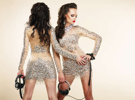 platinum hair: Fete. Clubbing. Two Women in Shiny Silver Dresses with Rhinestones