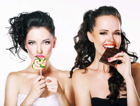 parody: Burlesque. Parody. Couple of Women Sneers and showing a Fig Stock Photo