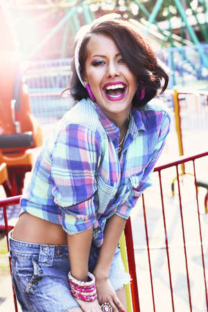 hilarity: Enjoyment. Gladness. Expressive Woman in Checkered Shirt with Toothy Smile Stock Photo
